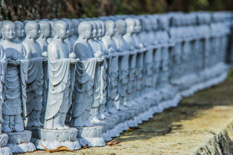 Buddha sculptures in the park of Kamakura. Religious symbols of Japan. 2013.01.06, Kamakura, Japan. Buddha sculptures in the park of Kamakura. Religious symbols stock photos