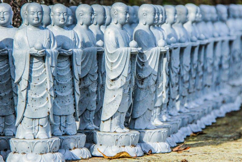 Buddha sculptures in the park of Kamakura. Religious symbols of Japan. 2013.01.06, Kamakura, Japan. Buddha sculptures in the park of Kamakura. Religious symbols stock photo