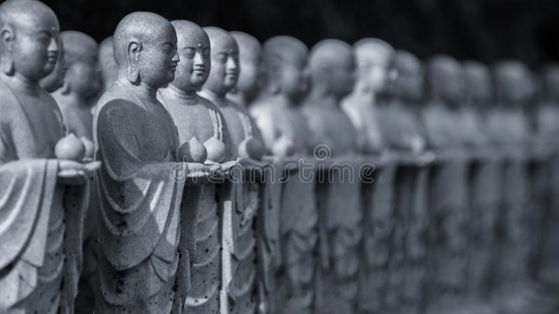 Buddha sculptures in the park of Kamakura. Religious symbols of Japan. 2013.01.06, Kamakura, Japan. Buddha sculptures in the park of Kamakura. Religious symbols royalty free stock images