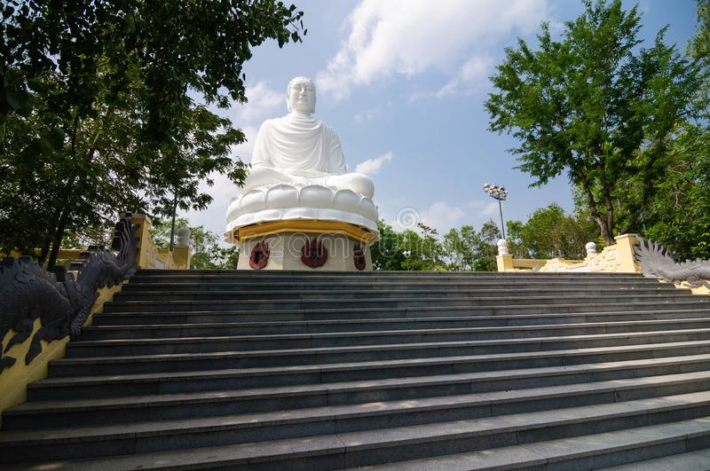 Buddha sitting on the hill of long Son temple, Vietnam stock photography