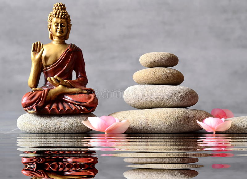Buddha is sitting in ZEN garden stock photography