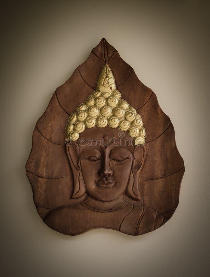 buddha som snider handen - gjort thailand trä royaltyfri bild