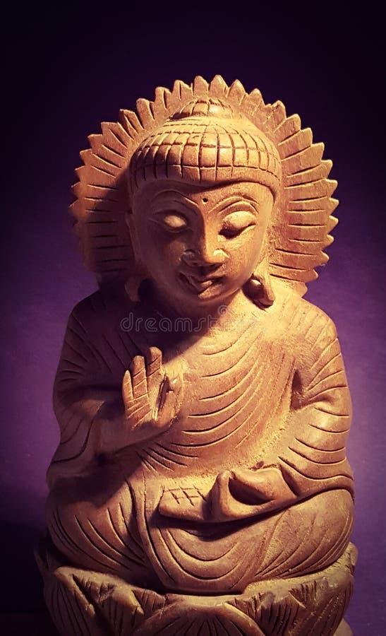 Buddha spiritual leader. Buddha meditative figure carved in sandalwood stock photo