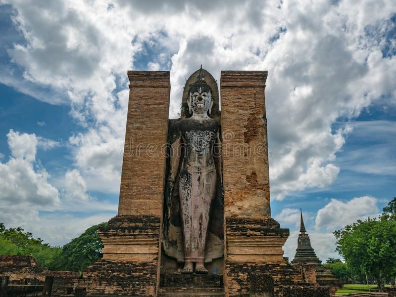 Buddha stand Statue in Wat mahathat Temple Area At sukhothai historical park. Sukhothai city Thailand stock photos