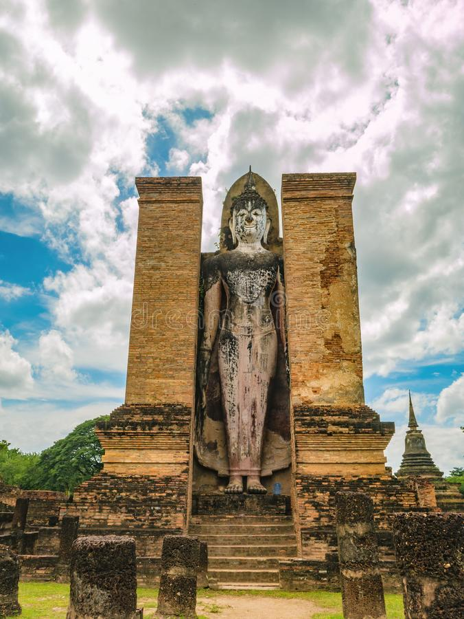 Buddha stand Statue in Wat mahathat Temple Area At sukhothai historical park. Sukhothai city Thailand royalty free stock photos