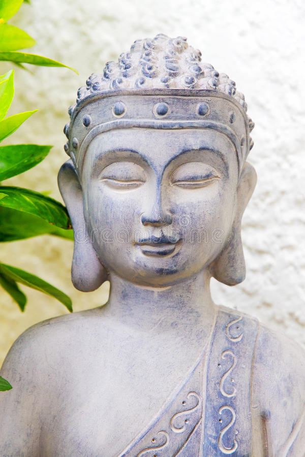 Buddha Statue. Grey Buddha statue with closed eyes stock images