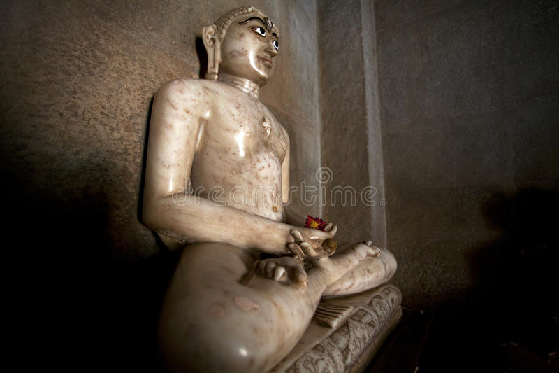 Buddha statue in the Adinatha Temple in Ranakpur stock image