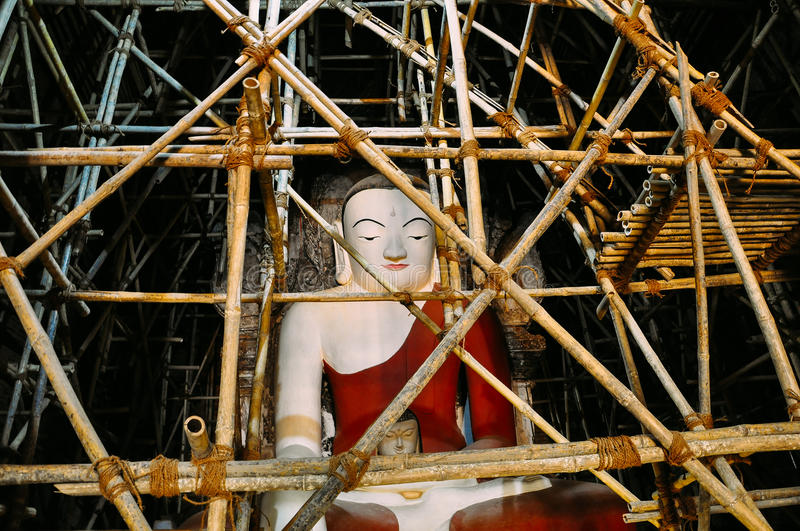 Buddha statue being restored in Bagan. stock image