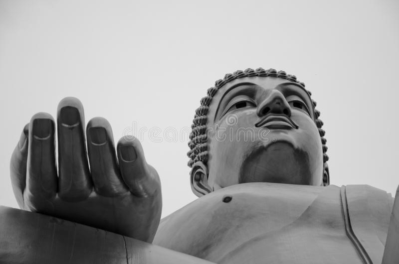 Buddha statue bottom-up view black and white stock photography