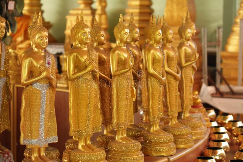 Buddha statues in various postures. Buddha statue that Buddhists respect royalty free stock image