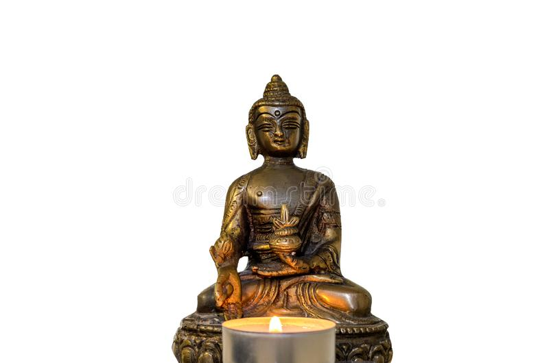 Buddha statue with burning candles isolated on white background royalty free stock images