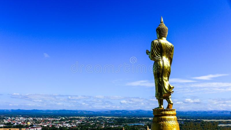 Buddha statue on city view with blue sky background in Thailand royalty free stock image