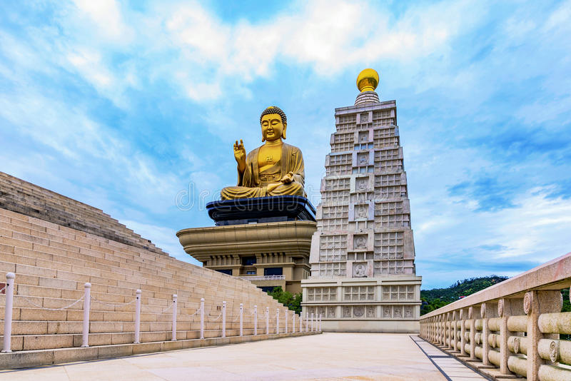 Buddha statue with cloudy sky. In the evening stock image
