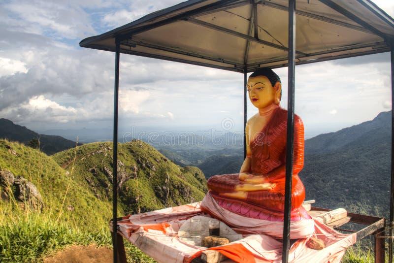 Buddha statue in Ella, Sri Lanka. Statue of the buddha on Little Adam's Peak in Ella in Sri Lanka royalty free stock images