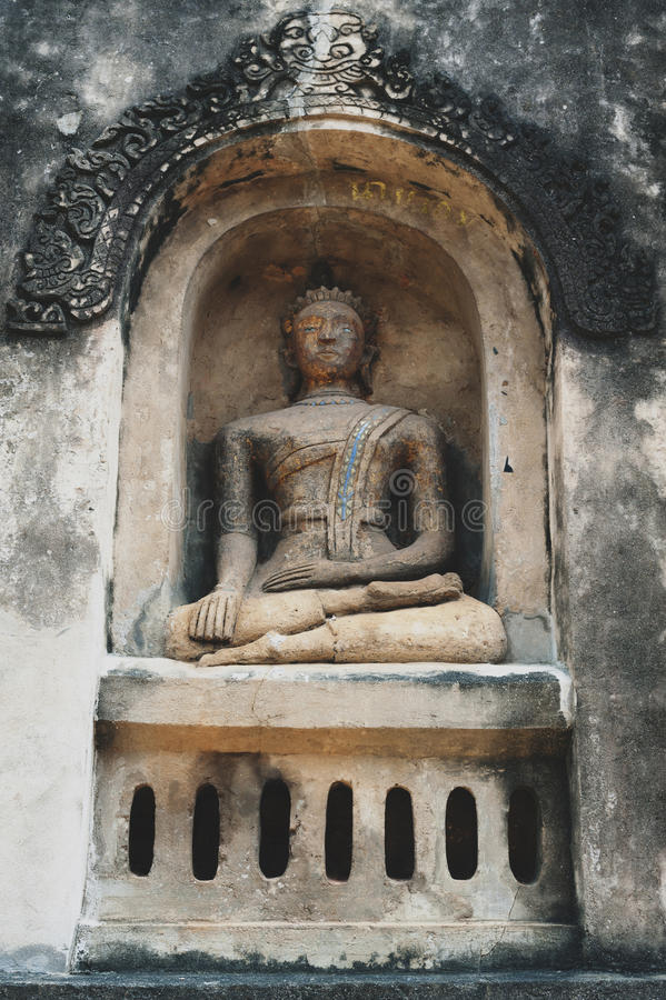 Buddha statue enshrined at Ku Phra Kona in Roi Et province, Northeastern Thailand. Buddha statue enshrined at Ku Phra Kona, group of Khmer prangs or pagodas royalty free stock photos