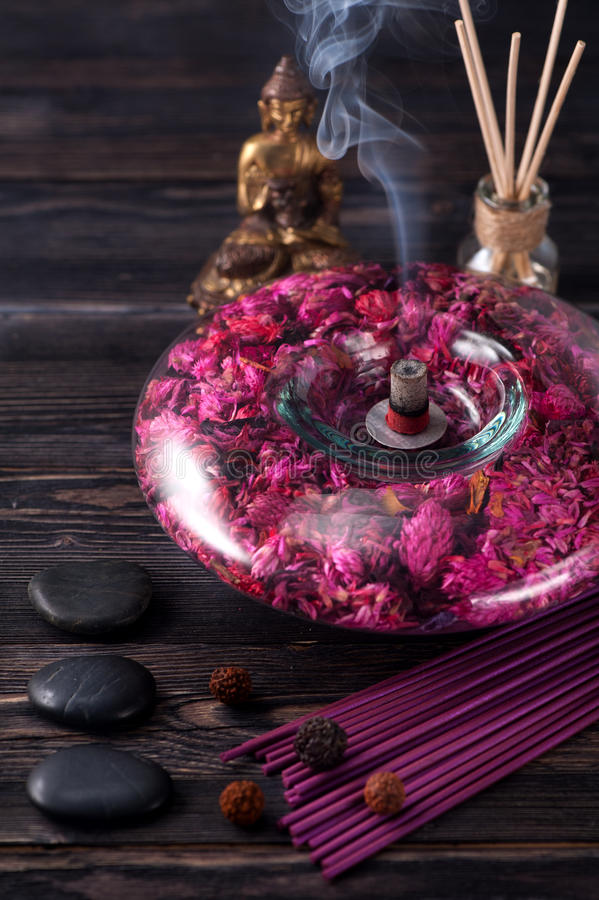 Buddha statue, essential oils, incense sticks and stones massage royalty free stock images