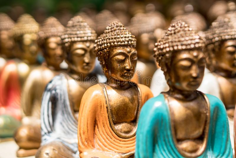 Buddha statue figures sold as a souvenir on a market stock photo