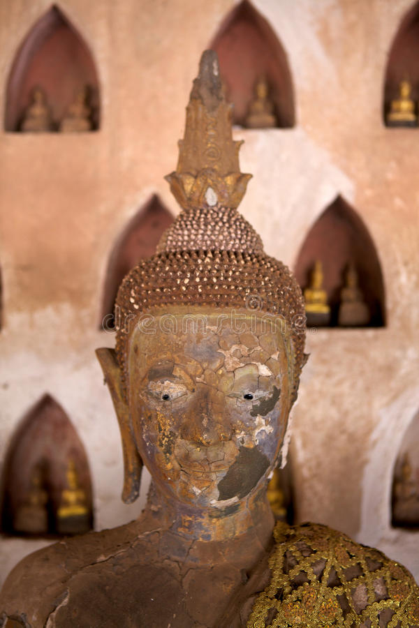 Buddha statue found in the cloister of Wat Si Saket, in Vientiane, Laos. Wat Si Saket is a Buddhist wat in Vientiane, Laos. It is situated on Lan Xang Road, on stock photography