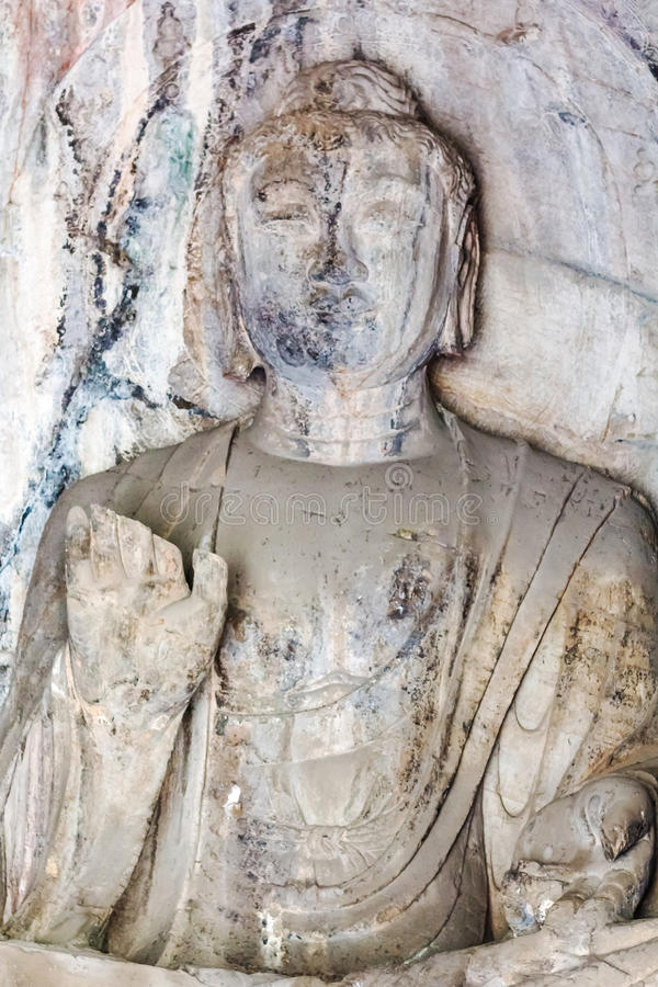 Buddha statue in grotto of Longmen Caves royalty free stock images