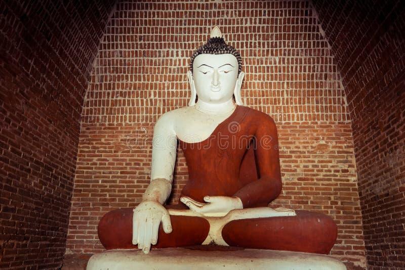 Buddha statue inside ancient Buddhist Pagoda ruins. Myanmar. Buddha statue inside ancient Buddhist Pagoda ruins. Architecture of old Temples at Bagan Kingdom stock photos