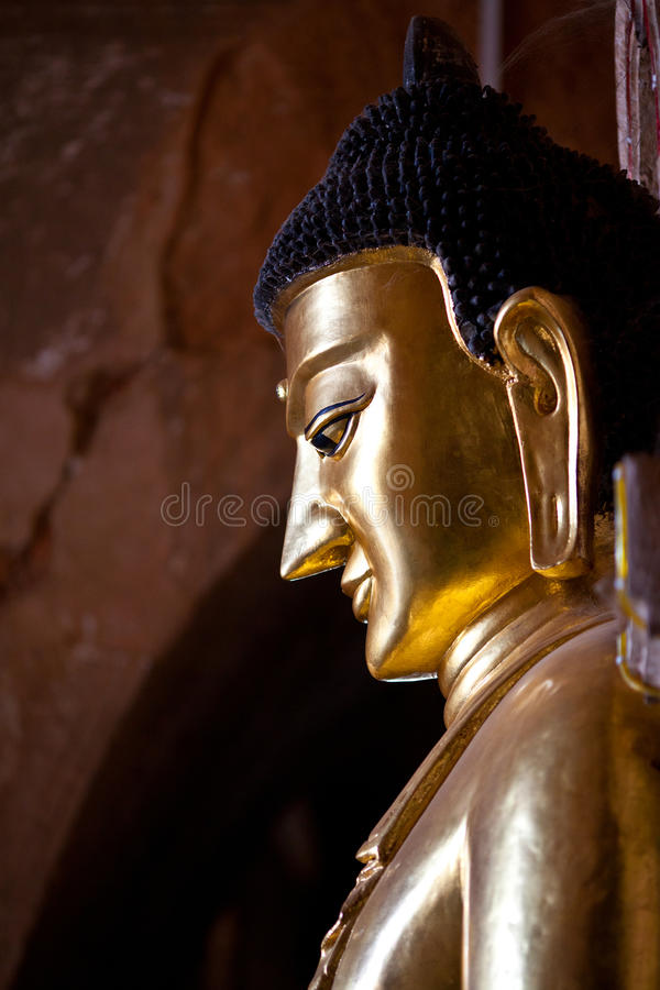 Buddha statue inside ancient pagoda in Bagan Kingdom, Myanmar. Buddha statue inside ancient pagoda in Bagan, Myanmar. Bagan's prosperous economy built over stock photo