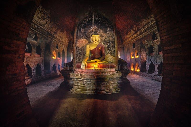 Buddha statue inside old pagoda at Bagan, Myanmar stock photography