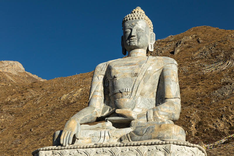 Buddha statue, Muktinath. Buddha statue in the temple of Muktinath, Nepal stock photo