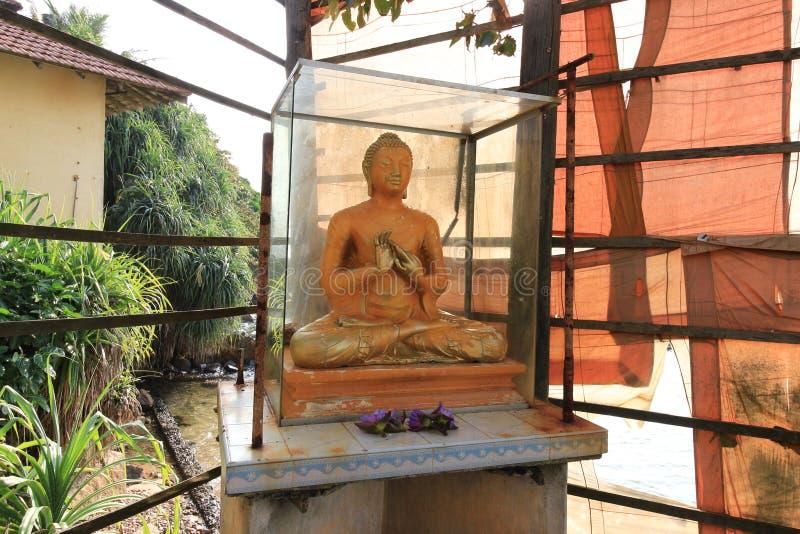 Buddha statue in Parey Dewa Rock in Water or Paravi Dupatha, temple in front of  Matara city, Sri Lanka stock image