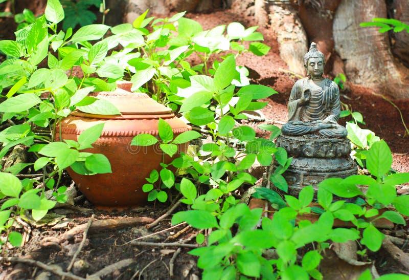 Buddha Statue With Pot Royalty Free Stock Photo