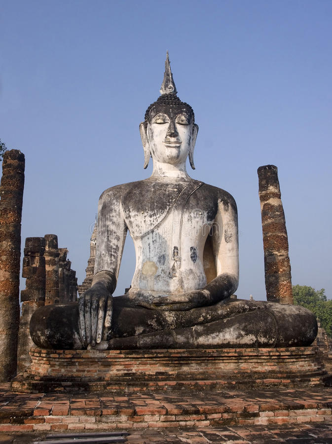 Buddha statue among the ruins of Old Sukhothai royalty free stock photography