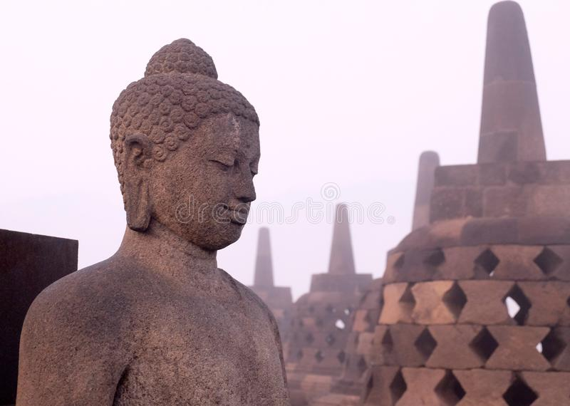 Buddha statue from the side royalty free stock image