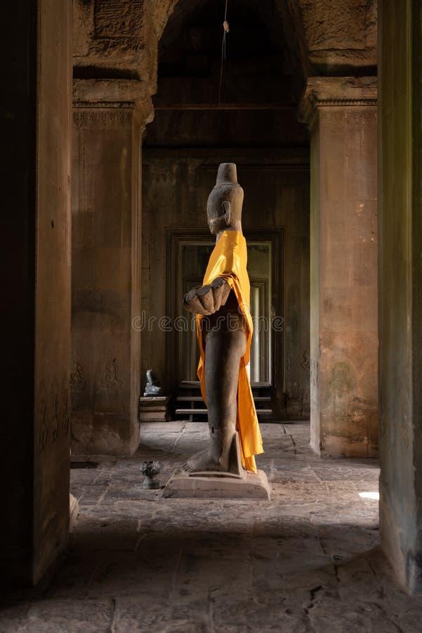 Buddha statue standing in Angkor Wat corridor stock image