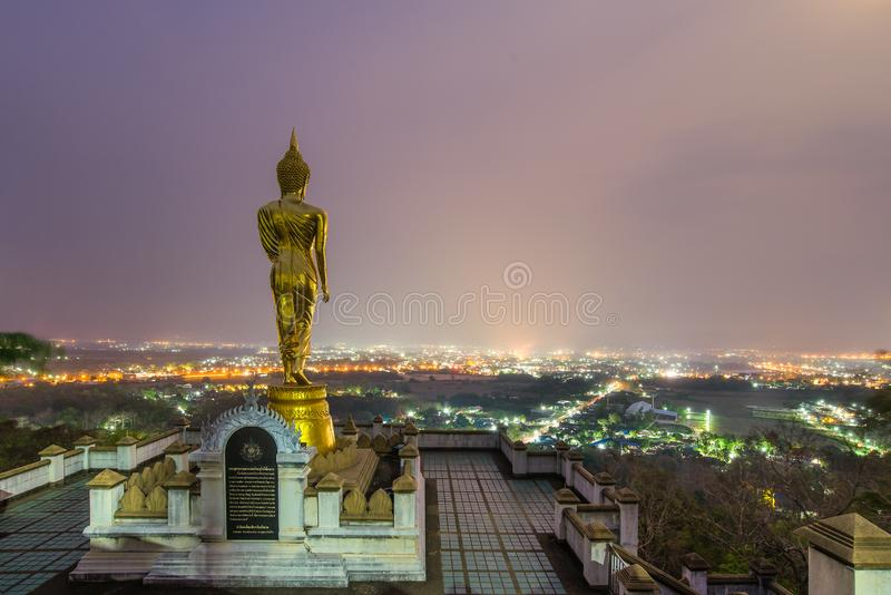 Buddha statue standing on a mountain at Wat Phra That Khao Noi, Nan, Thailand.  royalty free stock photography