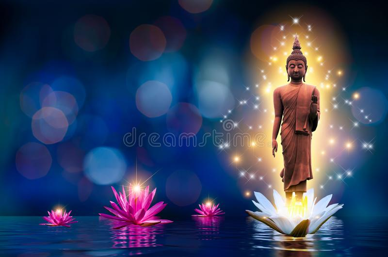 The Buddha statue stands on a white and pink lotus in the water. Bokeh blue background stock image