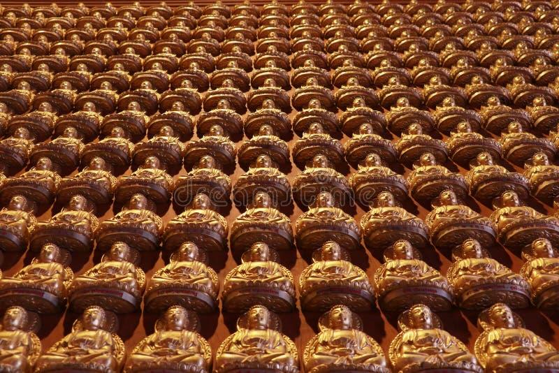 Buddha statue, stucco on chinese temple wall in Dragon Temple Kammalawat (Wat Lengnoeiyi) in Nonthaburi, Thailand stock photos