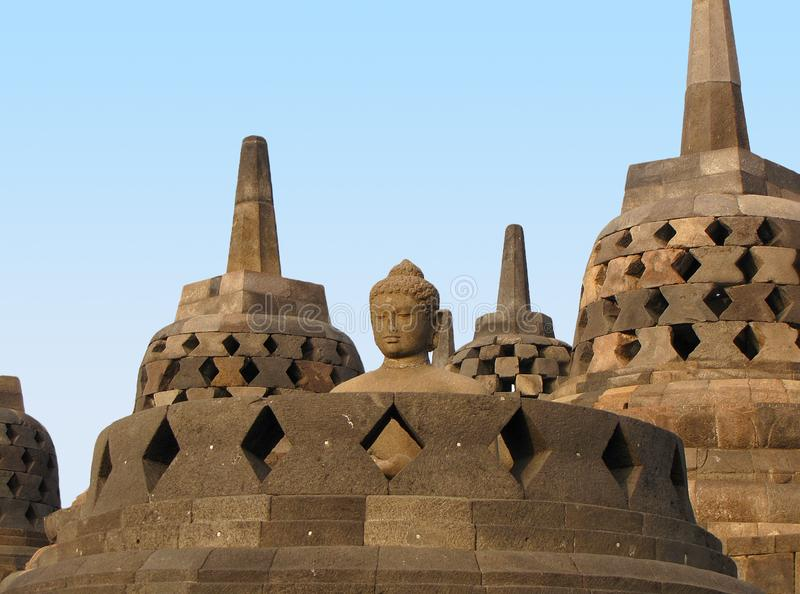 Buddha statue and stupas at Borobudur Temple, Indonesia royalty free stock image