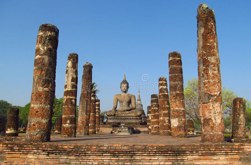 Buddha statue Sukhothai Historical Park in Thailand. Temple ruins and stone Buddha statues in Sukhothai Historical Park in Thailand, ancient capital of the  royalty free stock image