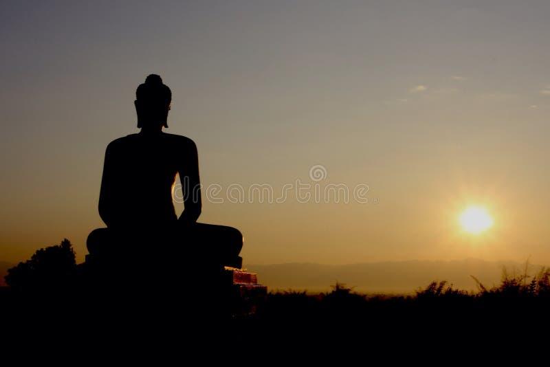 Buddha statue and sunrise royalty free stock images