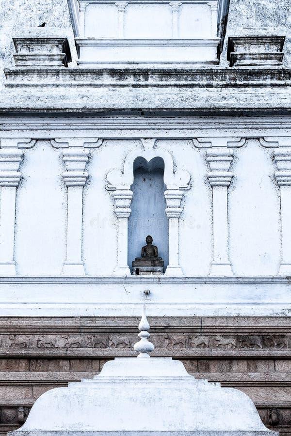 Buddha Statue in the wall of stupa in Anaradhapura stock photography