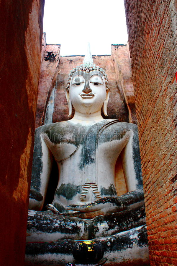 Buddha Statue. Wat Mahathat Seated Buddha Statue, Sukhotai historical park, Thailand The Sukhothai Art started from the reign of Poh Khun Si Inthrathit, the royalty free stock photography