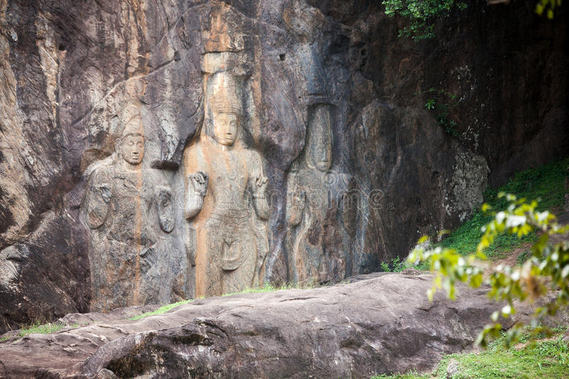 Buddha statues carved in rock at Buduruvagala temple in Sri Lank. A stock photos