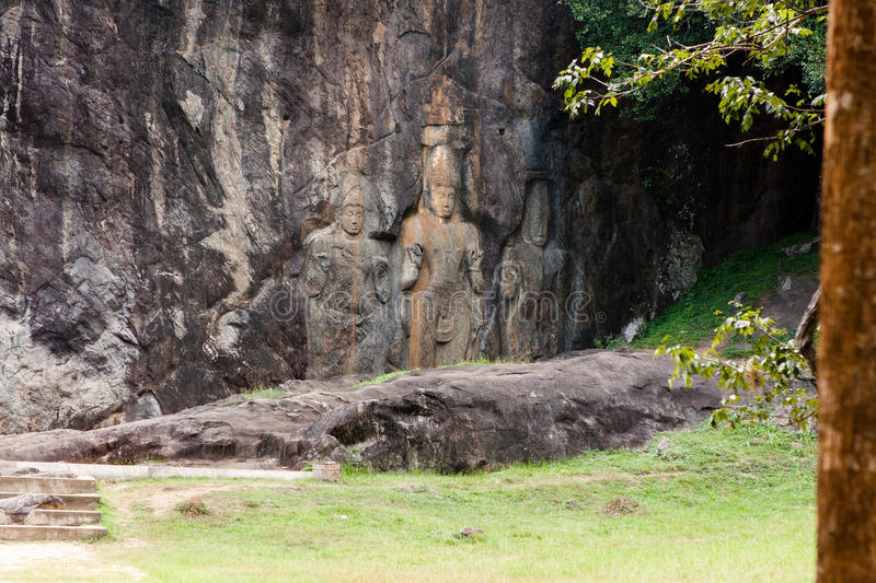 Buddha statues carved in rock at Buduruvagala temple in Sri Lank. A royalty free stock photos