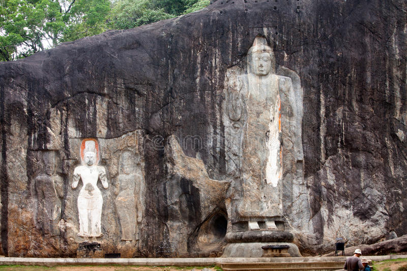 Buddha statues carved in rock at Buduruvagala temple. In Sri Lanka stock photography