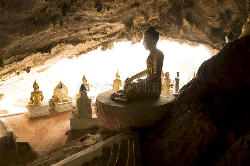 Buddha statues in a cave temple. Cave temple with backlight, buddha statues, Hpan, Myanmar stock photo