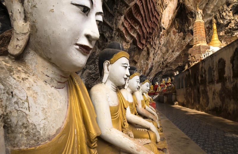 Buddha statues in a cave temple in Hpan, Myanmar. Row of buddha statues in a cave temple in Hpan, Myanmar stock photography