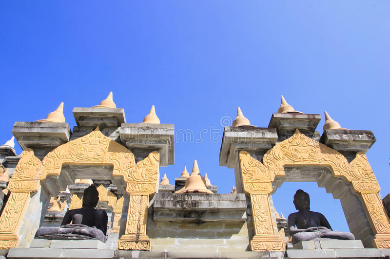 Buddha statues in Pa Kung Temple at Roi Et of Thailand. There is a place for meditation. ROI ET, THAILAND - NOV04,2015: Buddha statues in Pa Kung Temple at Roi royalty free stock photo