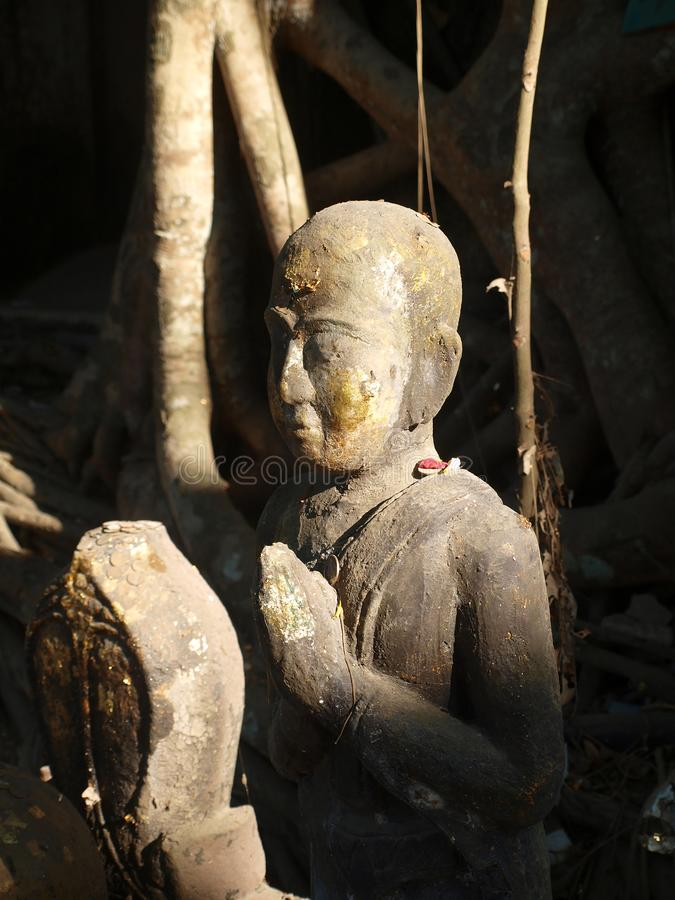 Buddha statues stand with peaceful, and the good lighting of the sunlight. stock image