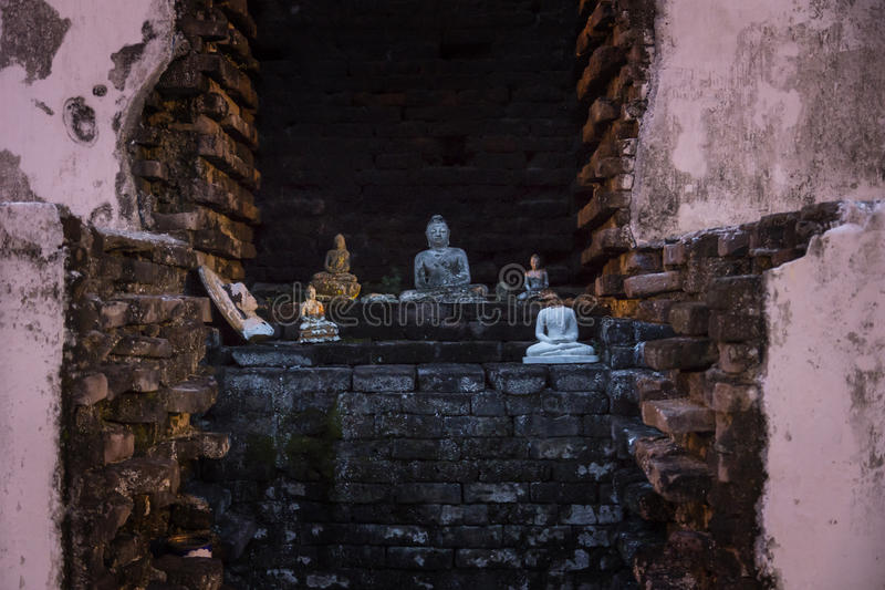 Buddha statues in a Temple of Tissa. Buddha statues in fron of bricks of a Temple stock images