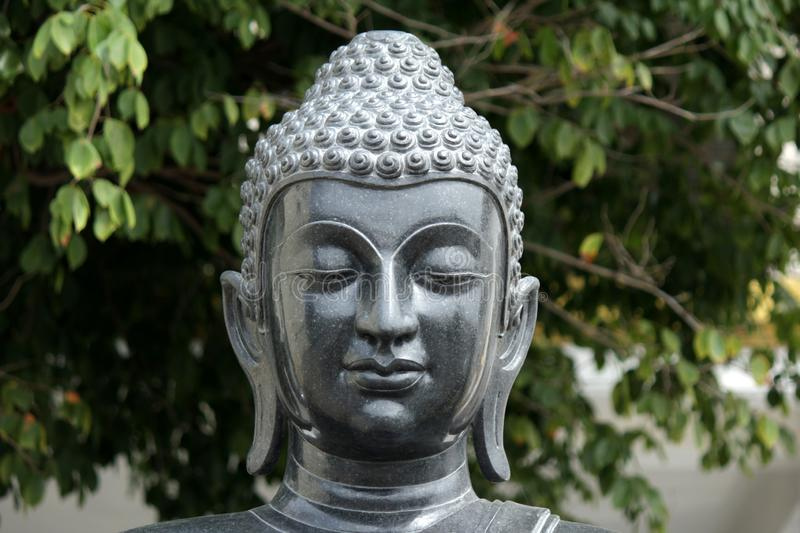 Buddha statues in various postures. Buddha statue that Buddhists respect royalty free stock photo