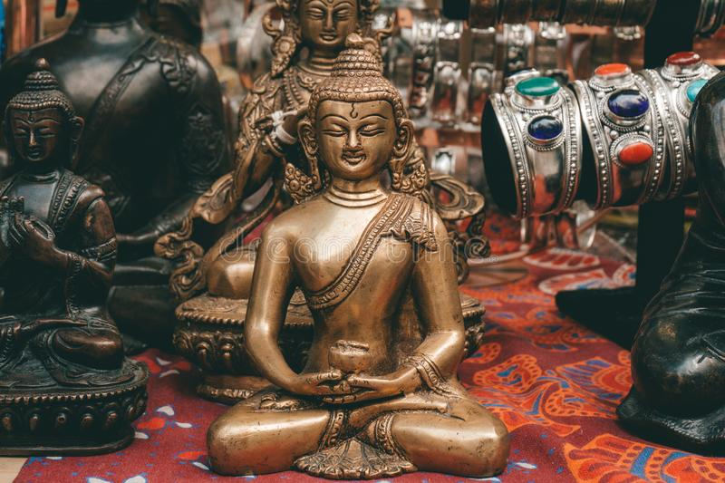 Buddha statuette in meditation. Souvenirs on the market in Kathmandu, Nepal royalty free stock images